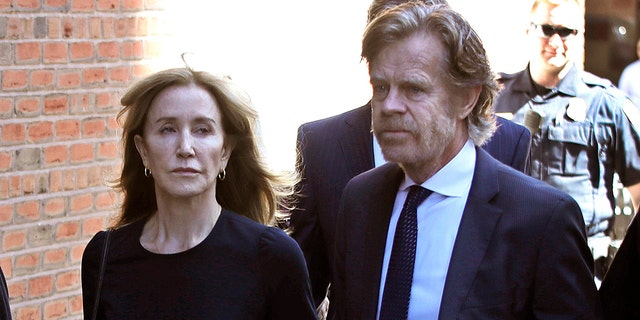 Felicity Huffman arrives in federal court with her husband William H. Macy for sentencing in a bribery scandal in nationwide, Friday, September 13, 2019, in Boston.