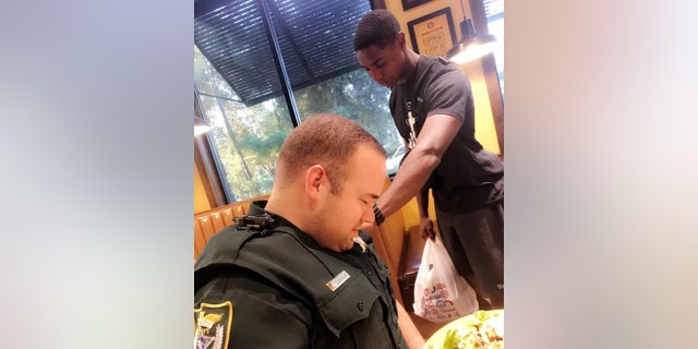 Juan O'Neal approached adeputy with the Volusia County Sheriff's Office Saturday and asked if he could pray over him.