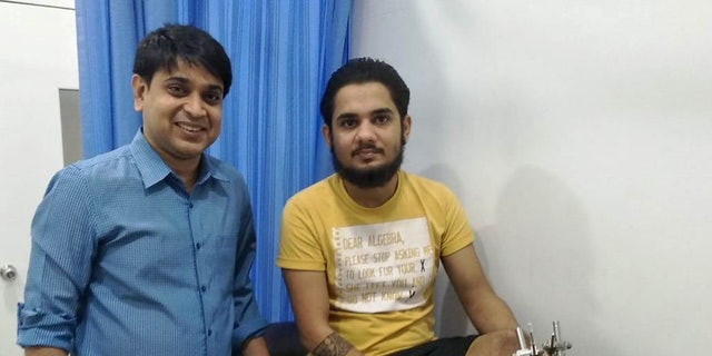 Karan Sharma (right) is seen after surgery to reattach his severed foot.