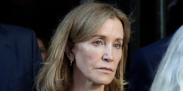 Actress Felicity Huffman leaves federal court after her sentencing in a nationwide college admissions bribery scandal, Friday, Sept. 13, 2019, in Boston.