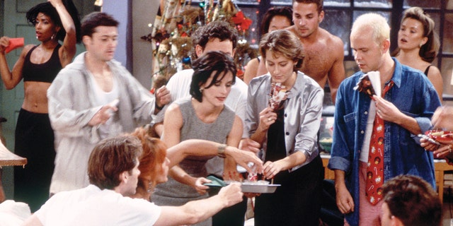 """FRIENDS -- """"The One with Phoebe's Dad"""" Episode 9 -- Pictured: Courteney Cox Arquette as Monica Geller (second from left), James Michael Tyler as Gunther."""