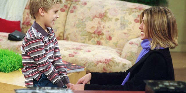 """Jennifer Aniston as Rachel Gree, right, and Cole Sprouse as Ben Geller"""" in the """"Friends"""" episode titled """"The One with the Truth About London"""" which aired on February 22, 2001."""