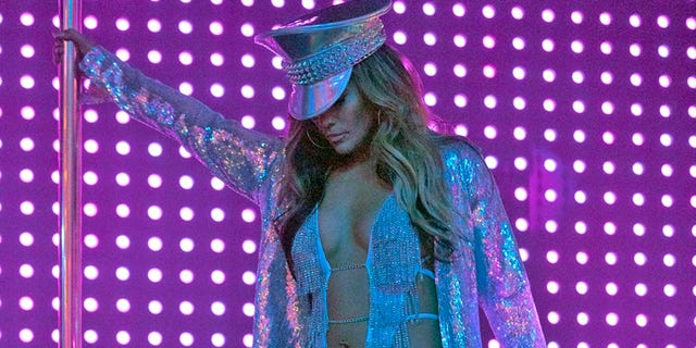"This image released by STXfilms shows Jennifer Lopez, in a scene from ""Hustlers,"" in theaters on Sept. 13. Lopez stars as Ramona, a leader of strippers in a Robin Hood-esque scheme to steal from rich men."