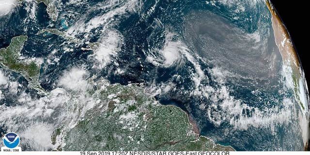 Tropical Storm Jerry strengthened into a Category 1 hurricane Thursday morning and is expected to pass north of Puerto Rico on Saturday and east of the Bahamas on Sunday before taking aim at an already storm-sacked Bermuda early next week.