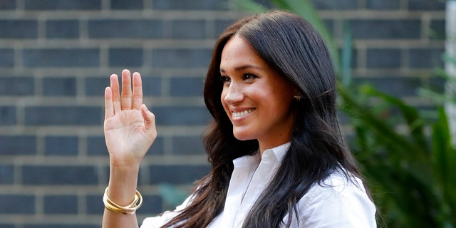 Meghan, the Duchess of Sussex, waves as she leaves a department store after launching the Smart Works capsule collection in London.