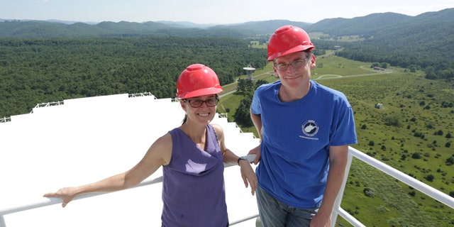 WVU's Maura McLaughlin and Duncan Lorimer use the Green Bank Observatory for research. Here, McLaughlin and Lorimer are standing on top the Green Bank Telescope, which they used to help detect the most massive neutron star ever. (CREDIT: Scott Lituchy/West Virginia University.)