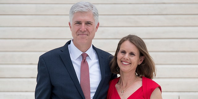 Justice Neil Gorsuch stands with his wife, Marie Louise Gorsuch, on the steps of the US Supreme Court in Washington, DC, June 15, 2017. / AFP PHOTO / JIM WATSON (Photo credit should read JIM WATSON/AFP/Getty Images)