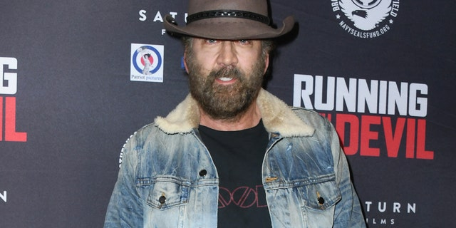 """Nicolas Cage attends the Premiere Of Quiver Distribution's """"Running with the Devil"""" at Writers Guild Theater on September 16, 2019 in Beverly Hills, California."""
