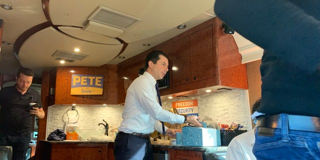 Pete Buttigieg grabs a cup of coffee while traveling across Iowawith reporters by bus. (Mitti Hicks/Fox News)