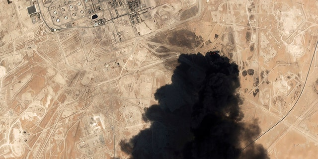 A satellite image from Planet Labs Inc. shows thick black smoke rising from Saudi Aramco's Abqaiq oil processing facility in Buqyaq, Saudi Arabia, following this past weekend's attack. (AP/Planet Labs Inc)