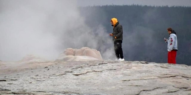 "On Sept. 10, two men were caught walking ""dangerously close"" to the spout of the legendary geyser and taking photos on their cellphones, as seen pictured here."