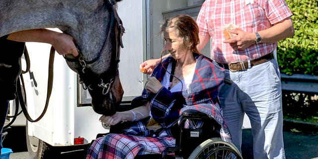 Tracey was reunited with her pet horse, Malone, thanks in part to her husband and hospice care team.