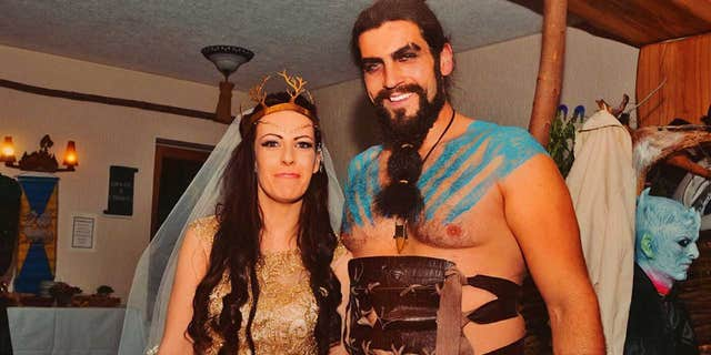 """Etz, pictured here with a guest dressed as a Dothraki warrior from """"Game of Thrones,"""" wore an """"elven""""-inspired dress to her wedding."""