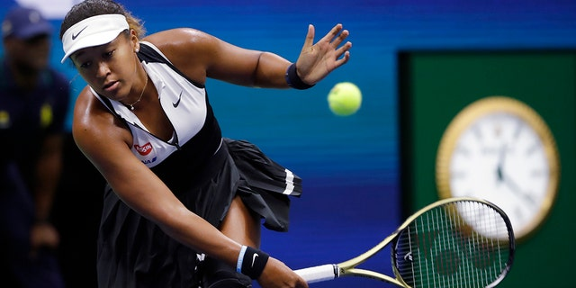 Naomi Osaka, of Japan, returns against Belinda Bencic, of Switzerland, during the fourth round of the US Open tennis championships. (AP Photo/Frank Franklin II)