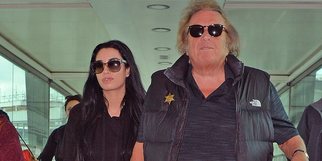 Don McLean and Paris Dylan arrive at Heathrow Airport on April 25, 2018 in London. The pair have been dating since McLean's contentious divorce.