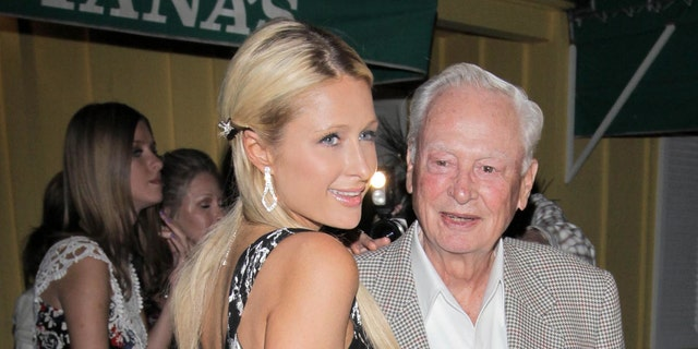 Paris Hilton has dinner at Dan Tana with her grandfather, Barron Hilton, in 2014. (Photo by Philip Ramey/Corbis via Getty Images)