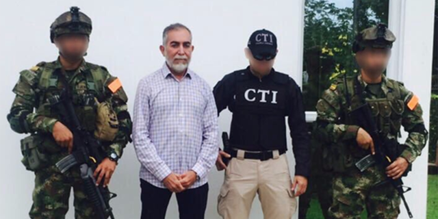 Jose Bayron Piedrahita-Ceballos, second from left, bribed a U.S. federal agent to have an indictment dismissed.