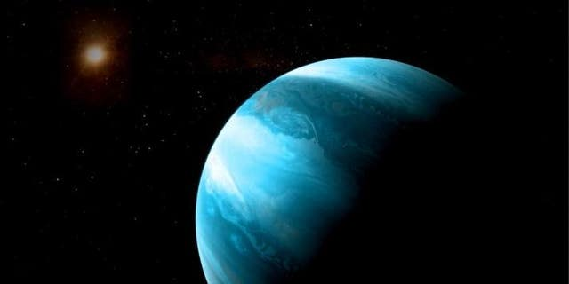 This artist's illustration paints the Jupiter-like planet GJ 3512b as a cloudy, blue world in orbit around a red dwarf star.