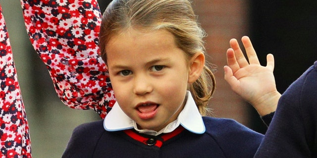 Britain's Princess Charlotte of Cambridge gestures as she arrives for her first day of school at Thomas's Battersea in London on Sept. 5, 2019.