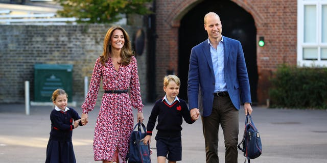 Princess Charlotte arrives for her initial day of school, with her hermit Prince George and her relatives a Duke and Duchess of Cambridge, during Thomas's Battersea in London on Sept. 5.