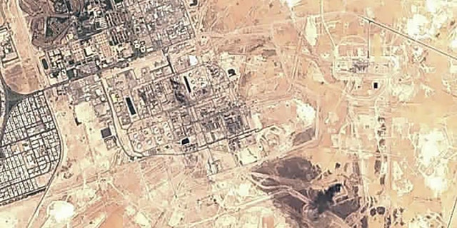 This Sunday, Sept. 15, 2019 false-color image from the European Commission's Sentinel-2 satellite shows Saudi Aramco's Abqaiq oil processing facility in Buqyaq, Saudi Arabia. Yemen's Houthi rebels claimed to have launched drone attacks on the world's largest oil processing facility in Saudi Arabia and a major oil field Saturday, sparking huge fires and halting about half of the supplies from the world's largest exporter of oil.