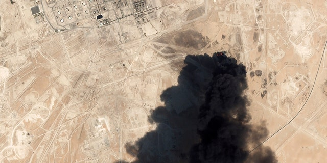Thick black smoke rising from Saudi Aramco's Abqaiq oil processing facility in Buqyaq, Saudi Arabia, on Saturday, captured in a satellite image. (Planet Labs Inc via AP)