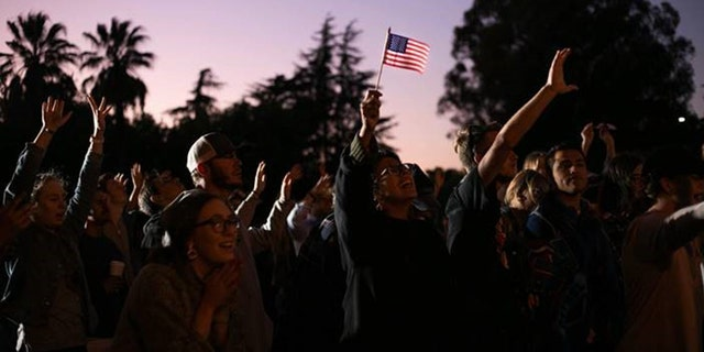 "People worship during the ""Rally for America"" at Andrews Park in Vacaville, Calif."
