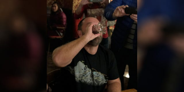 """Nick Griffiths elicited cheers from the crowd as he took his """"Sourtoe Cocktail"""" shot."""