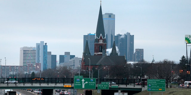 Traffic moves along a highway toward downtown Detroit, Michigan, U.S., on Wednesday, Dec. 10, 2014.