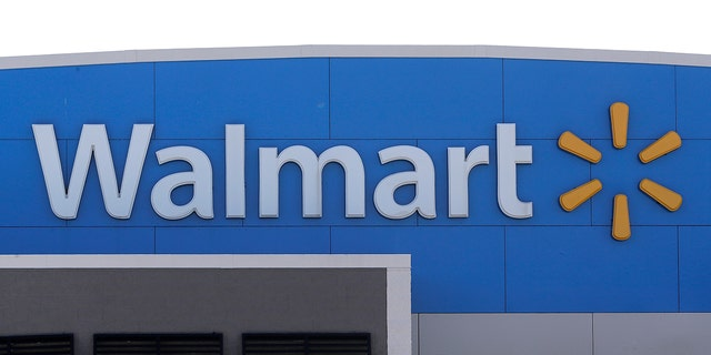 Walmart is going back to its folksy hunting heritage and getting rid of anything that's not related to a hunting rifle after two mass shootings in its stores in one week left 24 people dead in August of 2019. (AP Photo/Steven Senne)