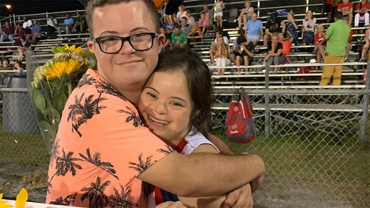 Heartwarming video shows boy with Down syndrome ask girlfriend to homecoming