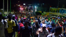Mexico halts caravan of 2,000 migrants bound for US; critics call roundup a 'human hunt'