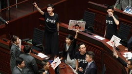 Hong Kong leader's annual address thwarted by protesters disrupting chamber