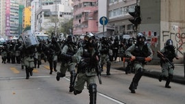 Hong Kong protesters sprayed with water cannon as they set up roadblocks, clash with police