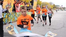 Illinois boy, 11, breaks world record, runs half marathon in all 50 states