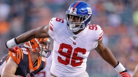 New York Giants' Kareem Martin delivers Super Bowl tickets to volunteer football coach with Down syndrome