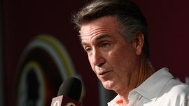 'Fire Bruce Allen' banner appears before Washington Redskins game in Miami