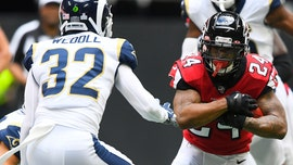 Falcons' Devonta Freeman ejected for throwing punch at Rams' Aaron Donald, sparking kerfuffle