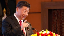 China's Xi Jinping warns attempts to divide country will end in 'crushed bodies and shattered bones'