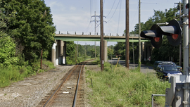 New York teens killed when Porsche falls over overpass, crashes on train tracks below