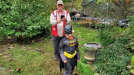 Sheriff's officer surprises boy, 6, with new Halloween costume after family loses home in fire
