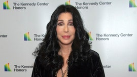 Cher offers to cover legal bills for fired school guard who used racial slur