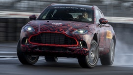The high-performance Aston Martin DBX SUV packs heat ... in a gun cabinet