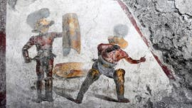 In Pompeii, scientists unearth gladiator fresco