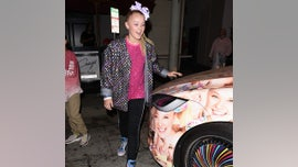 JoJo Siwa's Tesla Model X is covered in JoJo Siwas