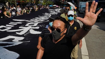 Hong Kong protesters defy mask ban in new round of demonstrations, as city braces for more