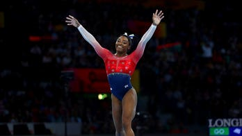Simone Biles breaks record with 21st medal at gymnastics world championships