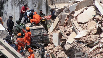 Brazil building collapse leaves at least 1 dead, other trapped under 鈥榣ayers of debris鈥�