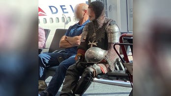 Man wears full suit of armor to airport