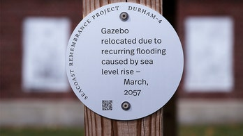 Climate change in 'history': New England artist uses signs to sound alarms